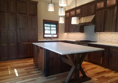 Interior Visions Crested Butte CO Walnut Kitchen with Starmark Cabinetry